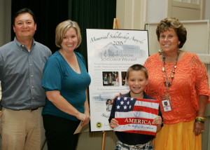 Aidan Butler with his parents and Mrs. Blue