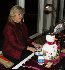 Sandy Baker at the piano