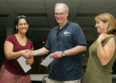 PTA President Naomi Hattaway being presented with check by President James McKenzie