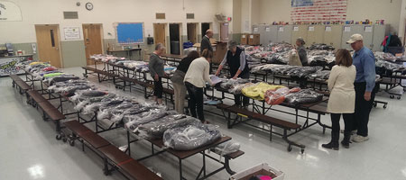 Inventory and sorting of the donated winter clothing.